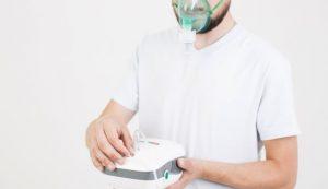 man-setting-medical-nebulizer